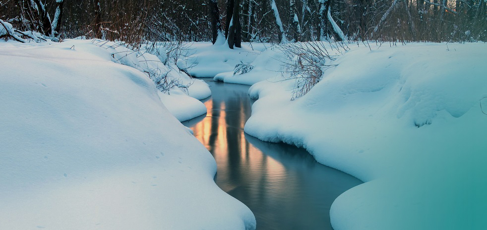 Winter landscape with small river in the twilight long exposure